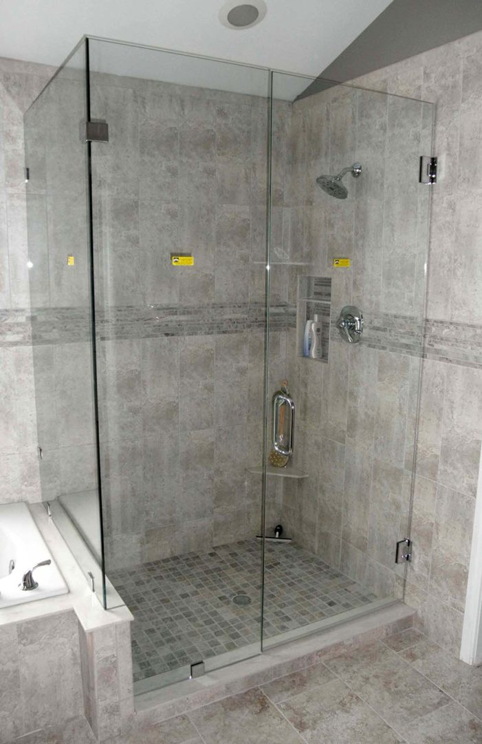 custom glass 90 degree shower enclosure on bench with clamps