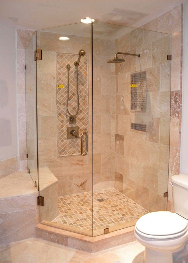 custom glass neo-angle shower enclosure on bench with clamps