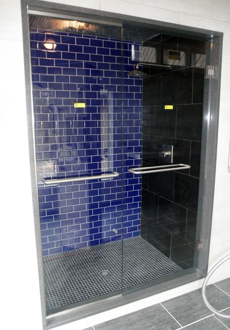custom glass door and panel steam shower enclosure with u channel