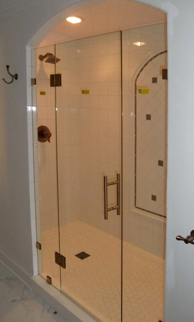 custom glass shower enclosure with clamps