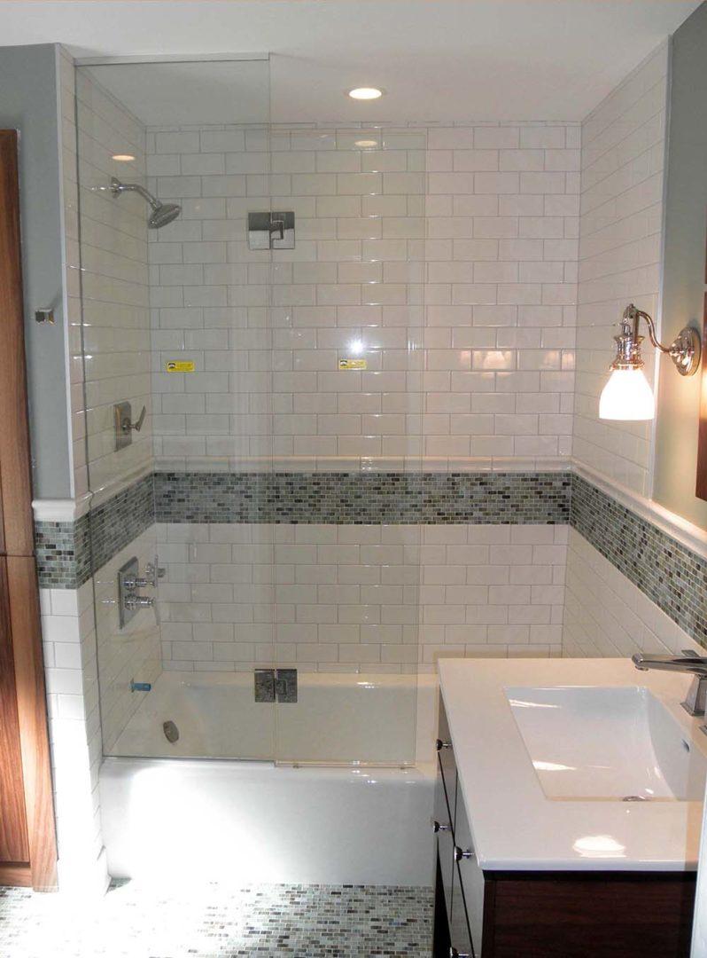 custom glass shower enclosure with u channel on bathtub