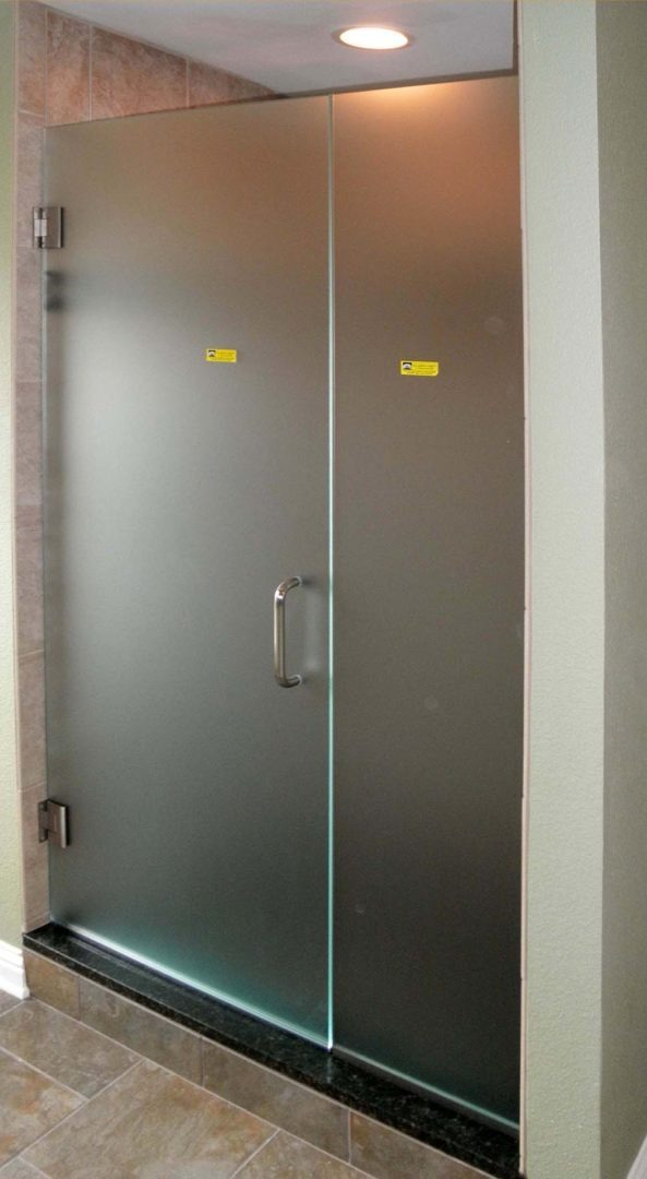 custom glass door and panel shower enclosure with acid etched glass with u channel