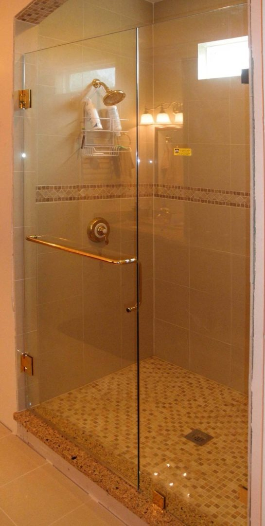custom glass door and panel shower enclosure with clamps