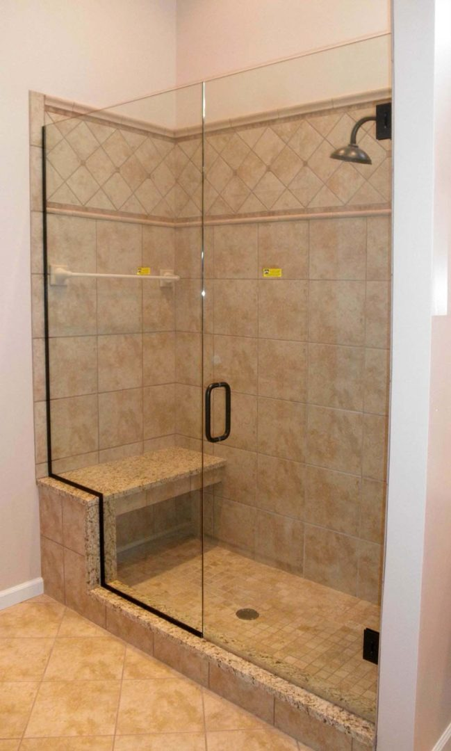 custom glass door and panel shower enclosure on bench with u channel