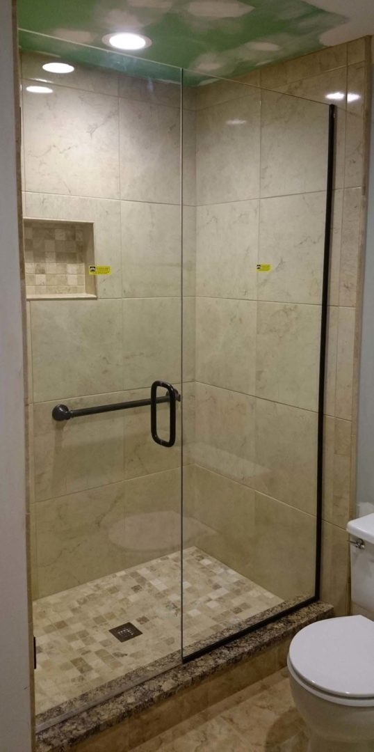 custom glass door and panel shower enclosure with u channel