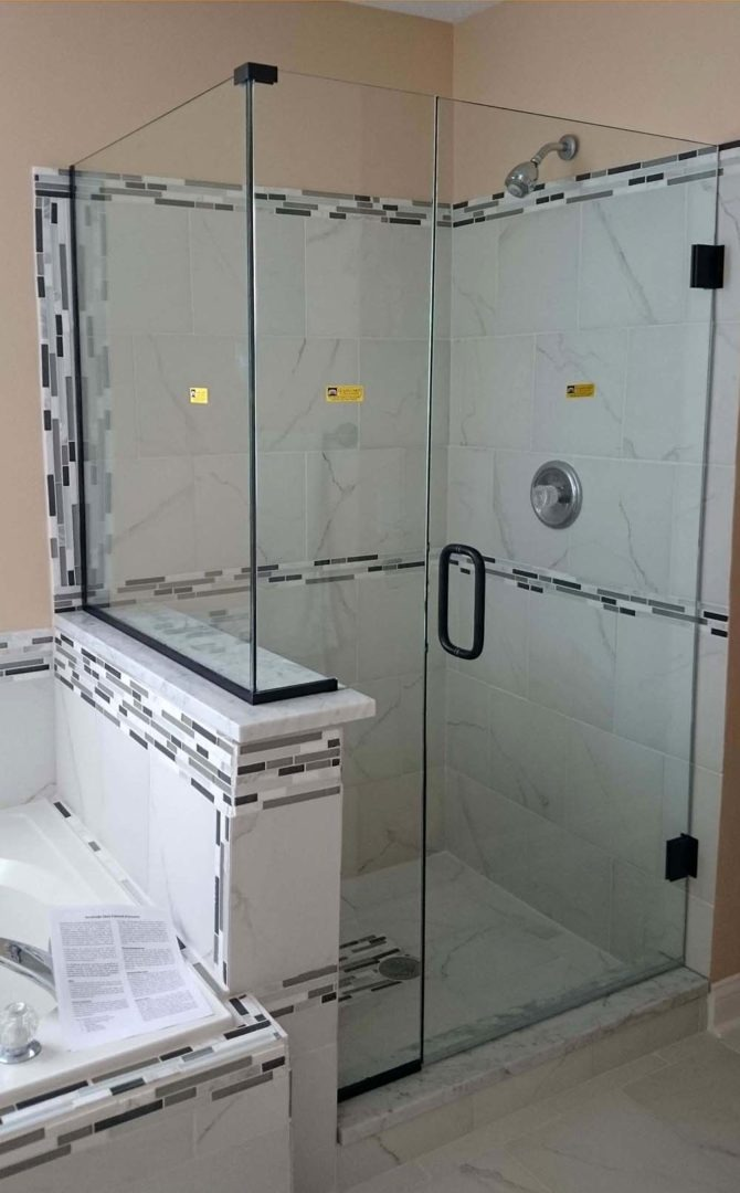custom glass 90 degree shower enclosure on knee wall with u channel