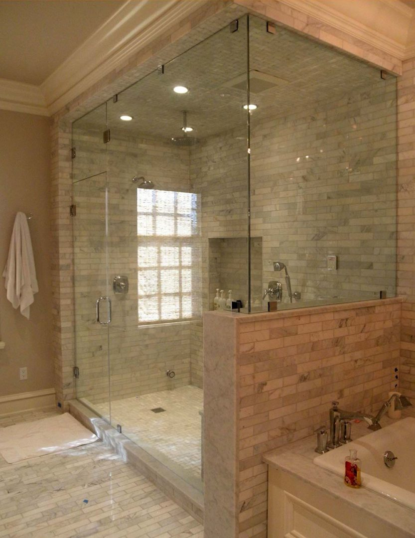 custom glass 90 degree shower enclosure on knee wall with clamps