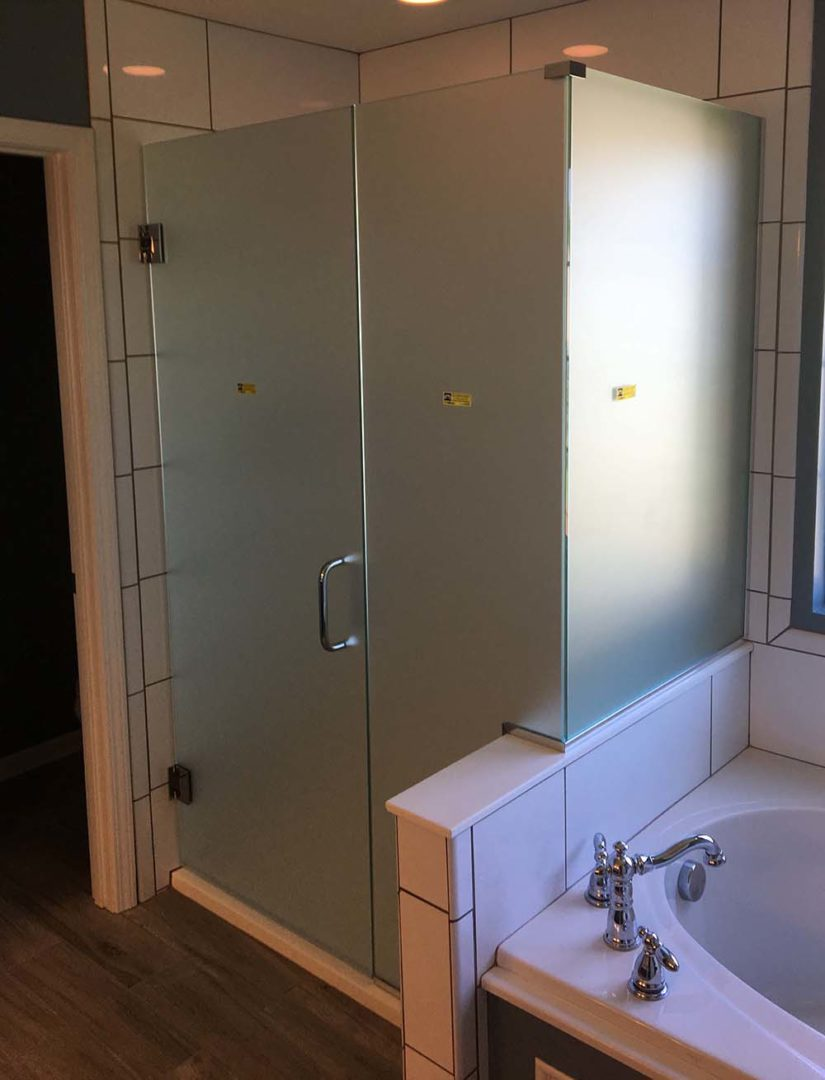 custom glass 90 degree shower enclosure on bench with u channel