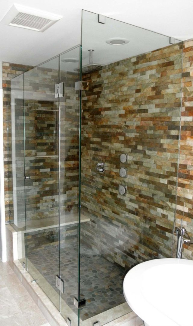 custom glass 90 shower enclosure on bench with clamps