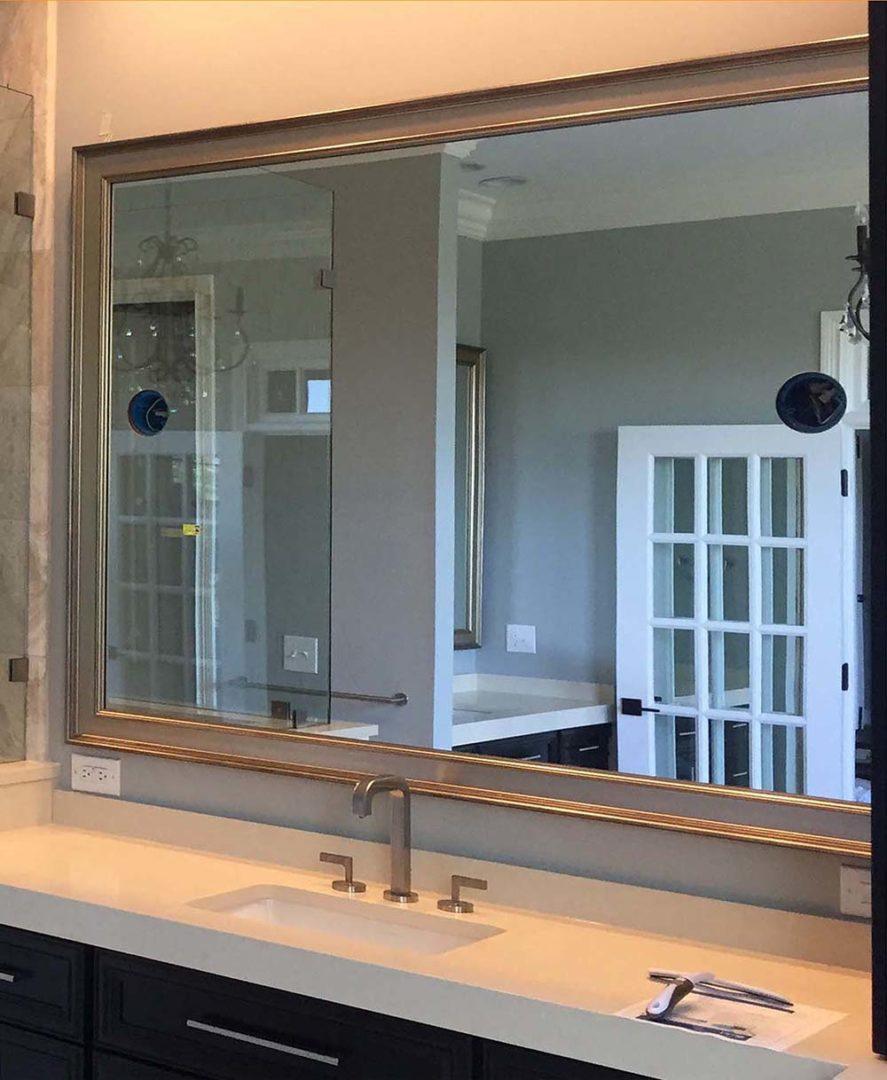 vanity mirror with cutouts in custom frame