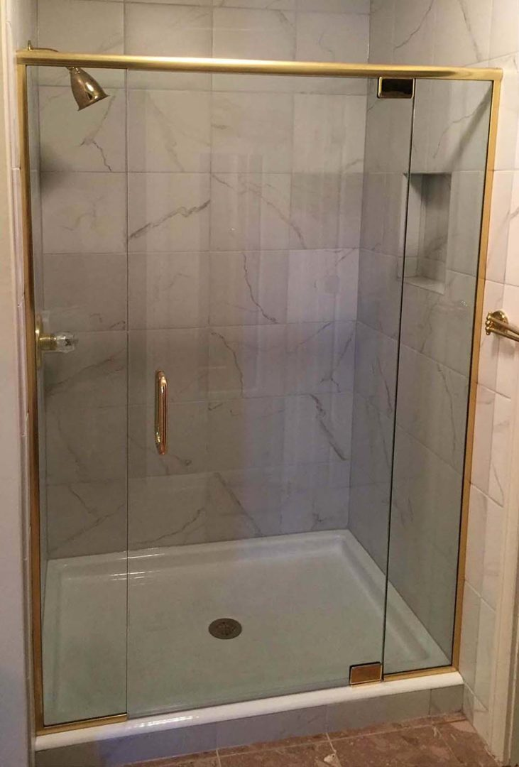 custom glass shower enclosure with header bar with u channel