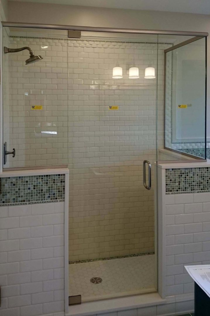 custom glass 90 degree shower enclosure on knee wall with header with u channel
