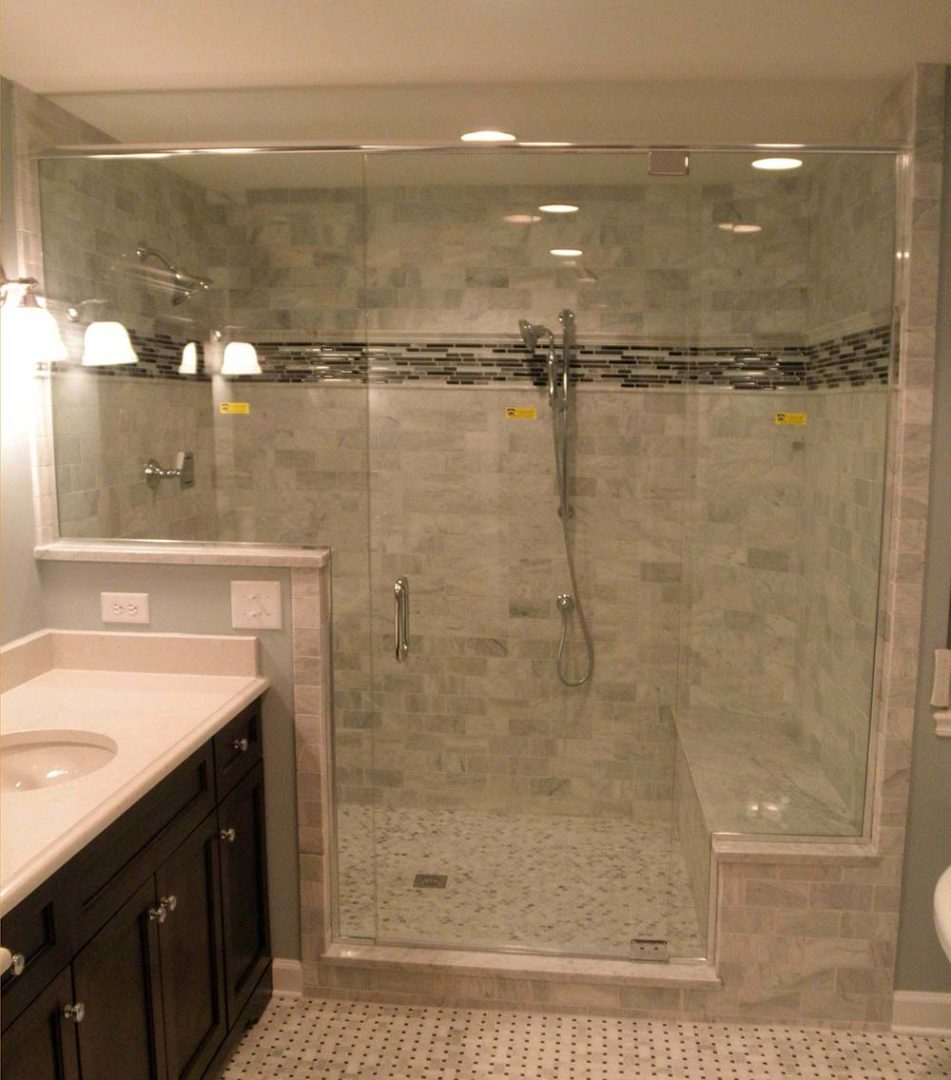 custom glass shower enclosure on bench with header bar with u channel