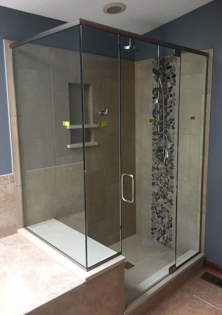 custom glass 90 degree shower enclosure on bench with header bar with u channel
