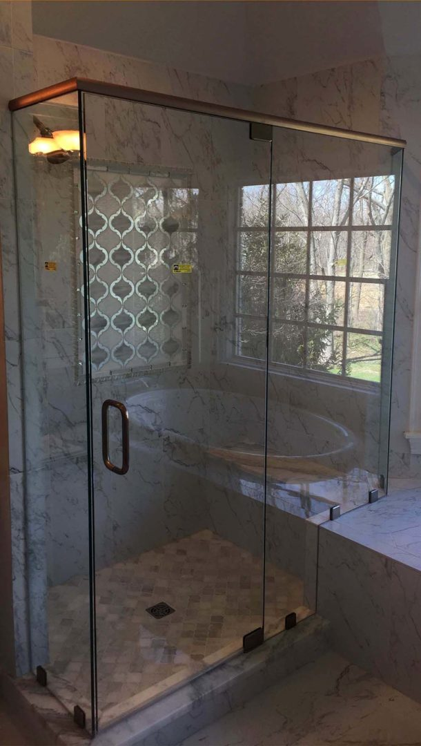 custom glass 90 degree shower enclosure on bench with header bar with clamps