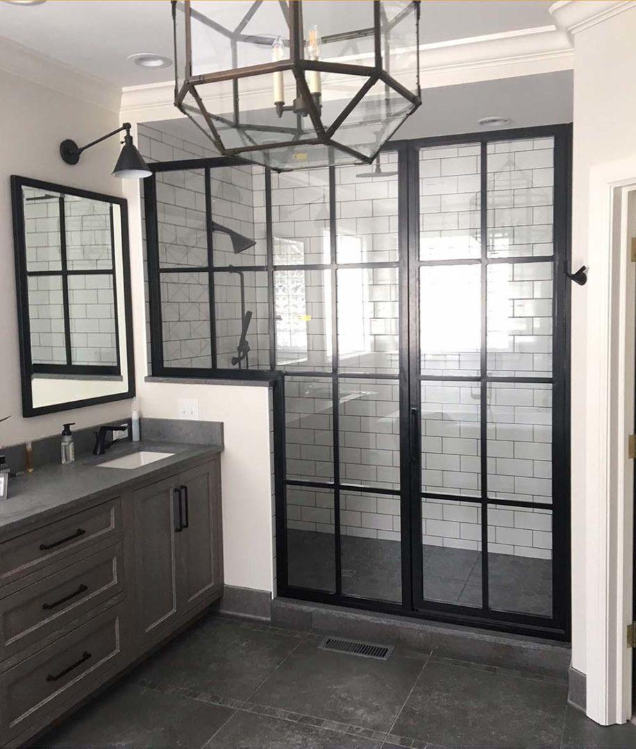 custom glass industrial shower enclosure on knee wall