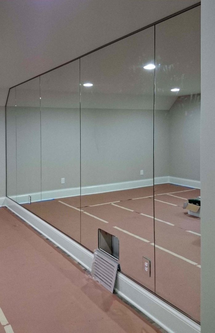 custom mirrored wall with cutouts