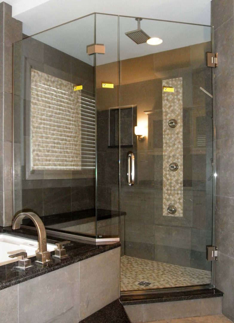 custom glass shower enclosure on bench with u channel