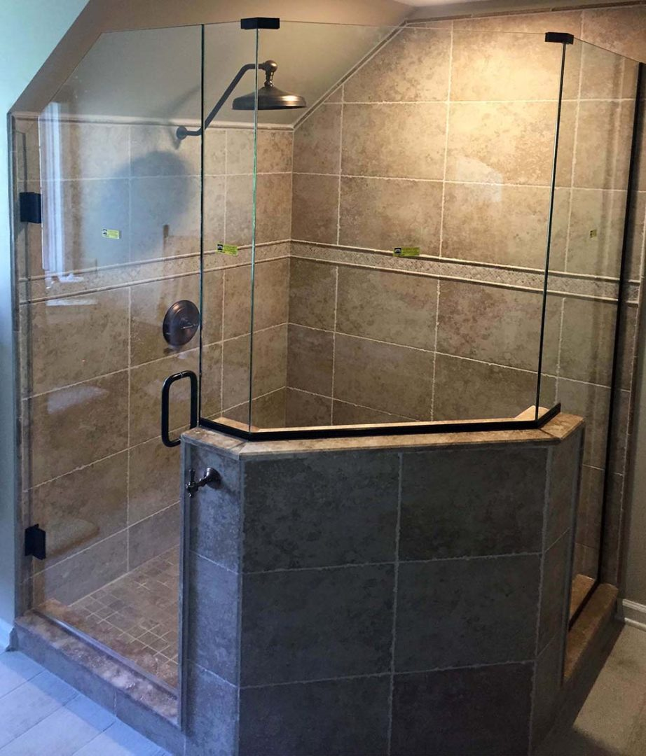custom glass neo-angle shower enclosure with u channel