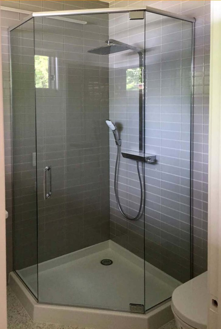 custom glass neo-angle shower enclosure with header bar with u channel