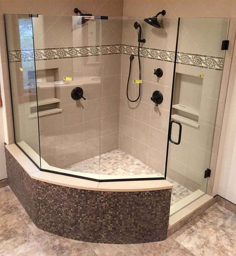 custom glass neo-angle shower enclosure on knee wall with u channel