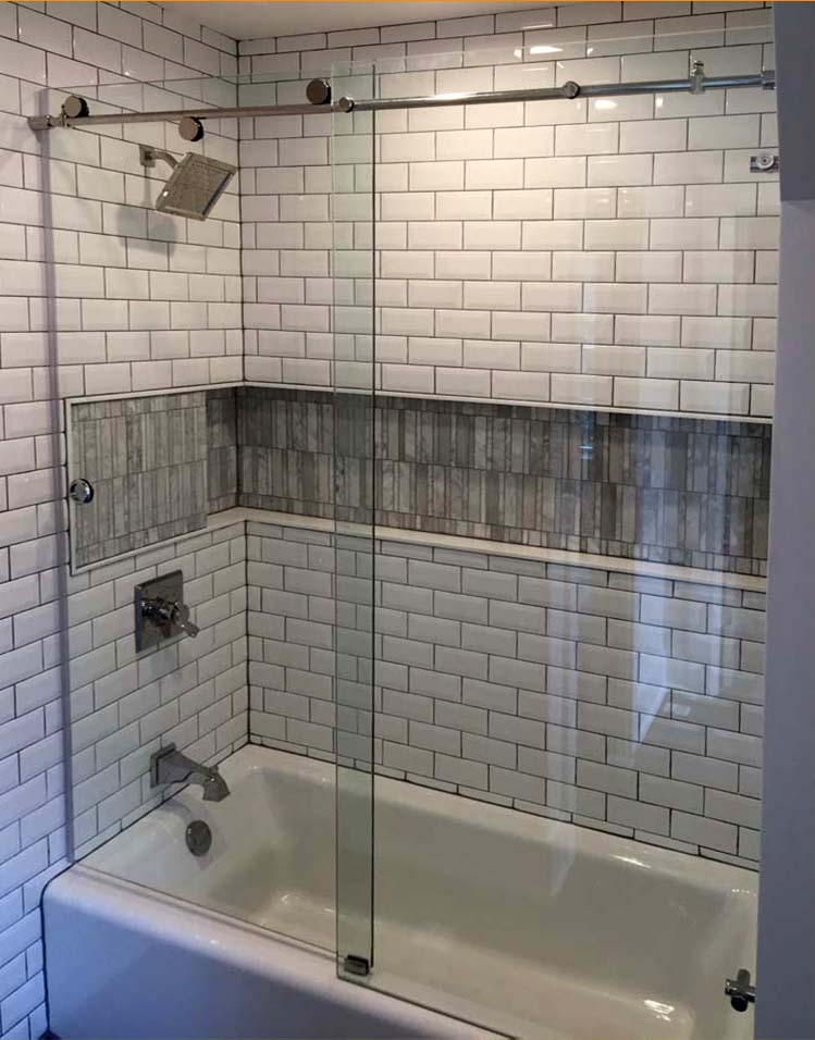 custom glass skyline shower enclosure on bathtub